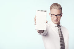 Confident businessman presenting empty notebook. Royalty Free Stock Photo