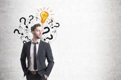 Confident businessman and questions, light bulb Stock Photos