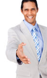 Confident businessman reaching out to shake hands Royalty Free Stock Image
