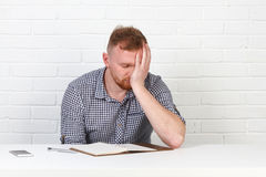 Confident businessman reading a contract. Businessman reading a contract in an Office behind a desk. Isolated. Emotions. Stock Image