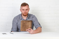Confident businessman reading a contract. Businessman reading a contract in an Office behind a desk. Isolated. Emotions. Stock Photography