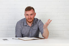 Confident businessman reading a contract. Businessman reading a contract in an Office behind a desk. Isolated. Emotions. Royalty Free Stock Photography