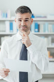 Confident businessman reading a contract Stock Photography