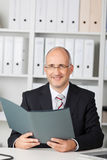 Confident businessman reading cv Royalty Free Stock Image