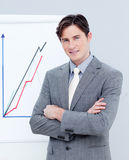 Confident businessman reporting sales figures Royalty Free Stock Images