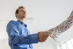 Confident businessman shaking hands with a woman Stock Photos