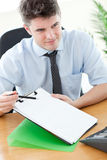 Confident businessman showing a contract royalty free stock image