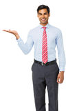 Confident Businessman Showing Invisible Product Stock Photo
