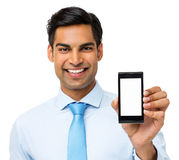 Confident Businessman Showing Smart Phone Royalty Free Stock Images