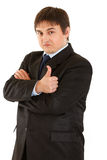 Confident businessman showing thumb up gesture Royalty Free Stock Photo