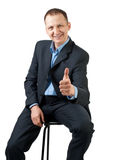 Confident businessman showing thumbs up Stock Photo