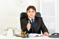 Confident businessman showing thumbs up gesture Royalty Free Stock Image