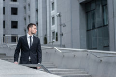 Confident businessman .  Side view of  young men in formalwear. Royalty Free Stock Photo