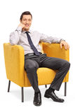 Confident businessman sitting in armchair Stock Images