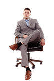 Confident businessman sitting on chair Royalty Free Stock Photography