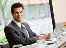 Confident businessman sitting in conference room Royalty Free Stock Photography