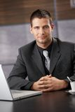 Confident businessman sitting at meeting table Royalty Free Stock Photography