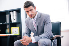 Confident businessman sitting on the office chair Royalty Free Stock Photo