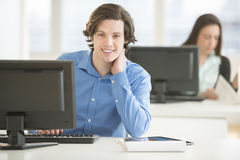 Confident Businessman Sitting At Office Desk Royalty Free Stock Images