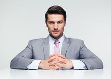 Confident businessman sitting at the table Stock Photos