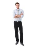 Confident businessman smiling arms crossed stock photo