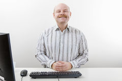 Confident Businessman Smiling At Computer Desk Royalty Free Stock Photography