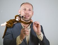 Confident businessman speaking at corporate business coaching and training auditorium conference room talking about monkey on. Young successful and confident stock photography