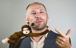 Confident businessman speaking at corporate business coaching and training auditorium conference room talking about monkey on. Young successful and confident royalty free stock photography