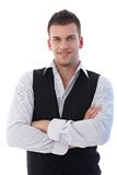 Confident businessman standing arms crossed Stock Images