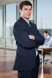 Confident Businessman Standing With Arms Crossed Stock Image