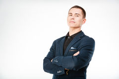 Confident businessman standing with arms folded Stock Photo