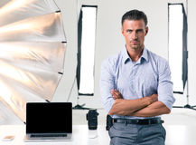Confident businessman standing with arms folded Stock Image