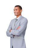 Confident Businessman standing with folded arms. Confident Afro-american Businessman standing with folded arms isolated on a white background Stock Photo