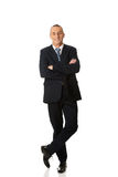 Confident businessman standing with folded arms Stock Image