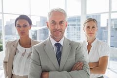 Confident businessman standing in front of colleagues Royalty Free Stock Photo