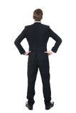 Confident businessman standing with hands on hips Stock Photo