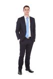 Confident businessman standing with hands in pockets Stock Photo