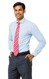 Confident Businessman Standing With Hands In Pockets Royalty Free Stock Image
