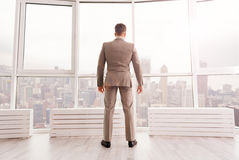 Confident businessman standing in his office Royalty Free Stock Photos