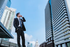 Confident Businessman standing and looking at city for vision co. Ncept Royalty Free Stock Photo