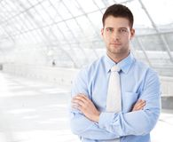 Confident businessman standing at modern passage stock photos
