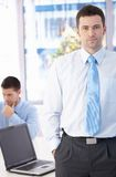 Confident businessman standing in office Royalty Free Stock Images