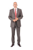 Confident Businessman Standing Over White Background Royalty Free Stock Photos