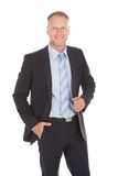 Confident businessman standing over white background Stock Photos