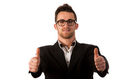 Confident businessman standing smiling with thumb up as a sign o Stock Images