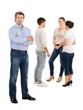 Confident businessman standing with team discussing Royalty Free Stock Images