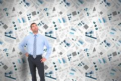 Confident businessman standing thinking with business newspapers in background. Digital composite of Confident businessman standing thinking with business Stock Photography