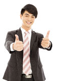 Confident businessman standing and thumb up Stock Photo