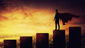 Superhero. Confident businessman standing on the top of a rising graph as a superhero with a cape watching the cityscape horizon at sunset. No limits growing stock images