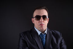 Confident businessman in sunglasses Royalty Free Stock Photos